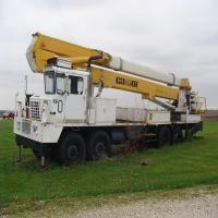 1990 Condor 3640 100' Boom Truck w/man basket, 8 axle, 4WD, 3 sp. transfer, out riggers